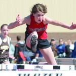 Nathan Oster: Vinaya Vanderploeg keeps her eye on the finish line as she clears a hurdle during Saturday's Greybull Invitational