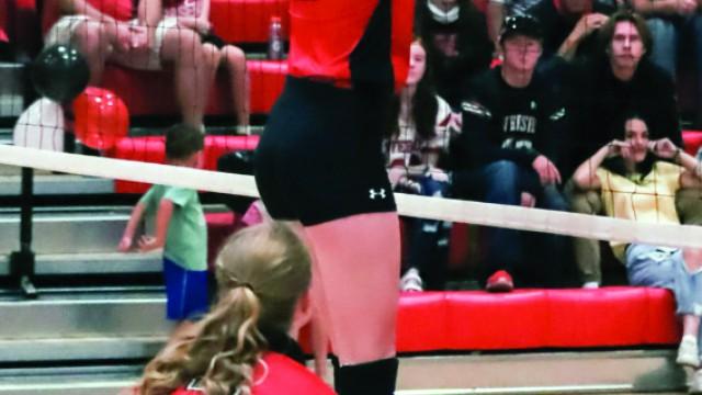 (Tammy Keele photo)  RHS Varsity Volleyball player Caroline Schlattmann blocks the ball during the Sept. 25 match against Shoshoni.
