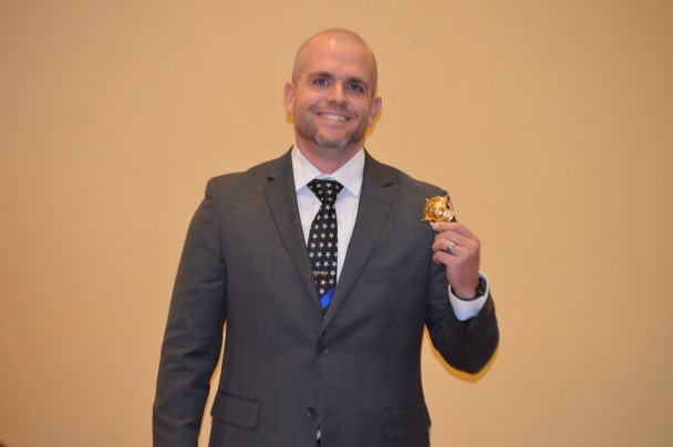 Barbara Anne Greene: Basin's new chief of police Kyle McClure holds up the badge he received after being sworn in.