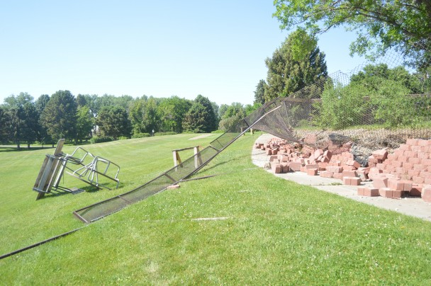 Barbara Anne Greene A retaining wall, fence and picnic table were destroyed by high winds on June 8 at the Wyoming Retirement Center.