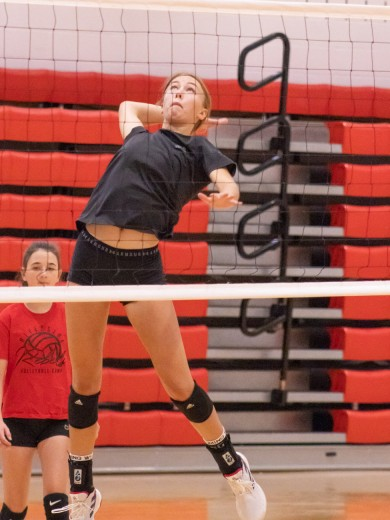 Tammy Keele Vaidyn Vanderploeg catches air during drills at the Lady Rebel volleyball practice Saturday morning.