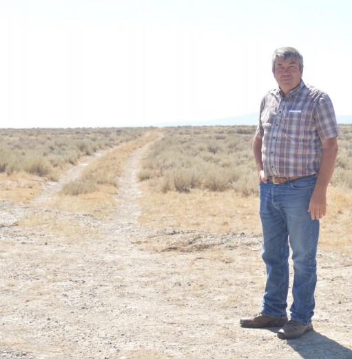 Barbara Anne Greene Burlington Mayor Jerry George standing near the ruts that mark where the Bridger Trail left the Greybull River and headed towards the Shoshone River.