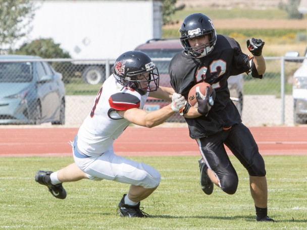 Tammy Keele Burlington junior Noah McMackin pushes for yardage during the Friday home game between the Hulett Devils and the Burlington Huskies.