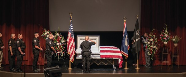 Law enforcement officers line up to pay their respects to Lt. Alva Ray Krogman during the viewing prior to funeral services at Worland Middle School on Wednesday. Krogman, a member of the U.S. Air Force, was killed in action in 1967 and his remains were returned to Worland for burial this week. (Photo by Avery Howe, Northern Wyoming News)