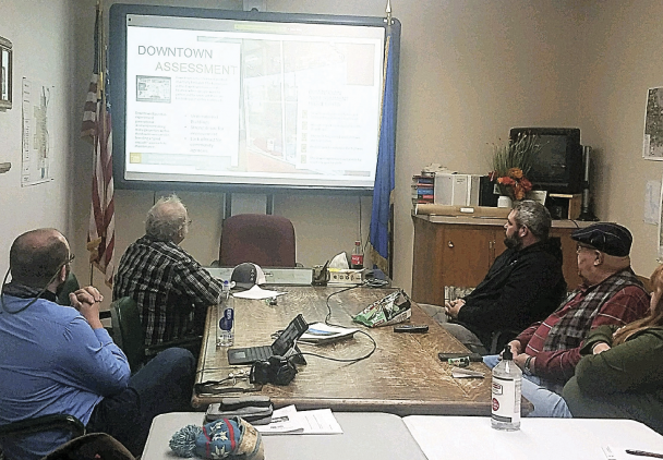 Members of the public, Town of Basin staff and elected officials review a power point about the findings of the Downtown Revitalization survey. Photo by Barbara Anne Greene