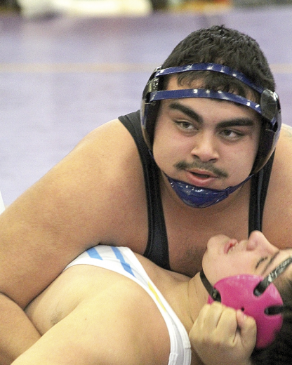 Lovell senior Cruz Garcia looks to the ref for the slap on the mat for a pin on Shoshoni wrestler Bobby White Saturday in the 285-pound third-place match at the 2A Northwest Quadrant Qualifier in Thermopolis. Sam Smith photo