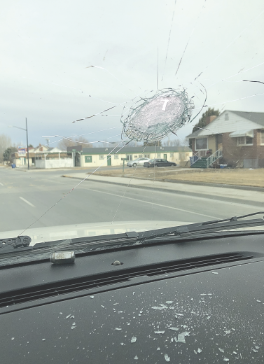 courtesy photo     The hole where a lug nut crashed through Kara Bischoff's windshield is pictured above, where glass was scattered across the vehicle's dashboard.