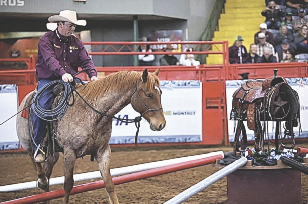 courtesy photo     Ken McNabb competes in the Road to the Horse competition, held last month. The competition, held in Texas, challenged competitors to train an untamed colt over the span of three days.