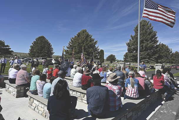 David Peck A sizeable crowd took advantage of the new special events facility at the Lovell Cemetery for Monday's Memorial Day ceremonies at the cemetery.