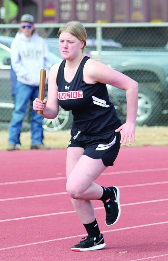 Sam Smith photo Lady Rebel sophomore Laila Davis begins her 200 leg of the 1,600 sprint-medley relay at the Bill Gerrard Invitational March 27, in Greybull