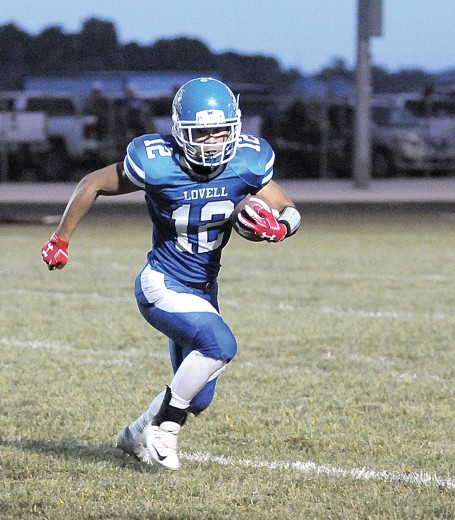 David Peck photo | Lovell junior Amos Monterde bursts to the outside for a gain during the Bulldogs' win over Thermopolis Sept. 25.