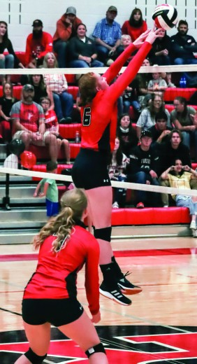 (Tammy Keele photo)  RHS Varsity Volleyball player Caroline Schlattmann blocks the ball during the Sept. 25 match against Shoshoni.