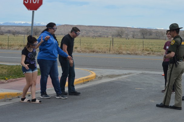 Barbara Anne Greene Burlington students attempted to do a sobriety test with Wyoming Highway Patrol last Friday. Pictured are Trooper Jason Roascio, (l-r) McKenna House, Sophia Mendez and Josh Tolman