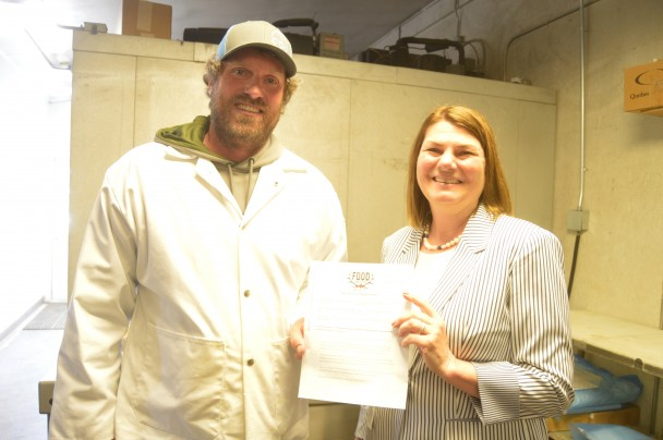 Barbara Anne Greene Paintrock Processing owner Tommy Searfoss and Wyoming's First Lady Jennie Gordon show off the agreement Searfoss signed to be a Food from the Field processor.