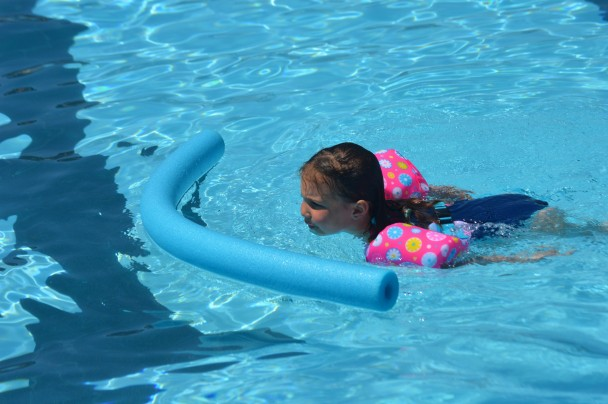 Jessica Robinson Audriana Otto swims after a pool noodle on opening day of the pool on Monday.