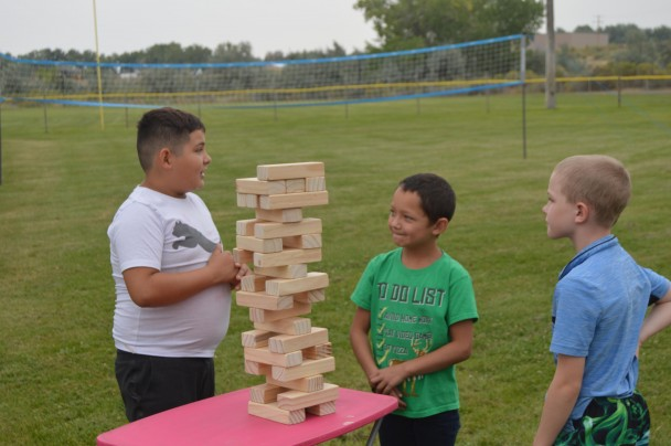 Barbara Anne Greene Contemplating jenga strategy are (l-r) Daniel Stamstad and Kingston Schedler of Greybull with Detrich Otto of Basin
