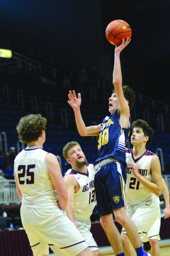 Freshman Coby Henderson floats through the lane against Big Horn at the State 2A Basketball Championships in Casper.