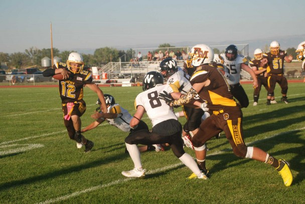 Quarterback Zane Horrocks evades a tackle as he stares down the next Wright defender in his path. Horrocks ran for multiple touchdowns in Friday's game.