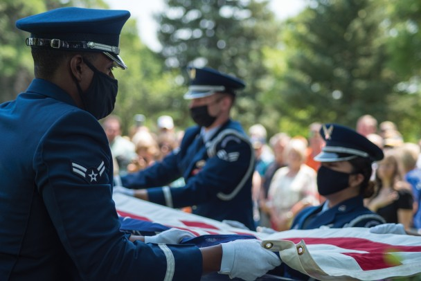 An honor guard folds the flag draped over the coffin of Lt. Alva Ray Krogman in Worland. Krogman, a member of the U.S. Air Force, was lost over Laos in 1967 and his remains were returned to his hometown of Worland this week. (Photo by Avery Howe, Northern Wyoming News)