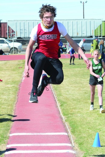 Nathan Oster: Avery Clifford lunges for extra distance in one of the jumping events.