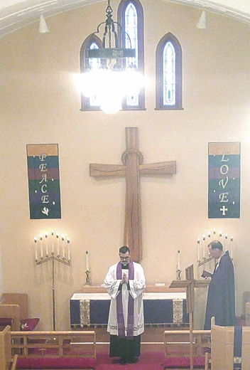 Pastor Benson prays the benediction over the congregation for the first time after his installation at St. John's Lutheran Church in Lovell.     courtesy photo