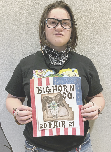 David Peck photo    Jaylynne Fink poses with her colored pencil drawing that won a contest to become the cover of the Big Horn County fair book this summer.