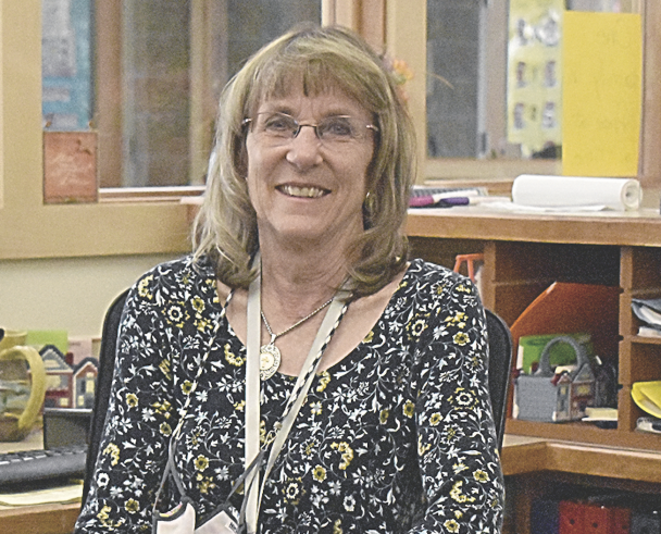 Lesley Boardman smiles frim the Rocky Elementary office, where she greets and meets the needs of visitors, staff and students every day.