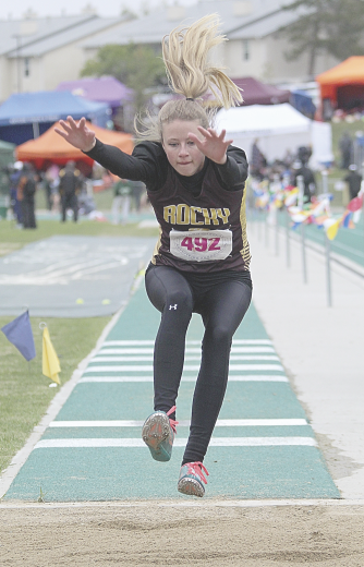 Sam Smith photo   Rocky Mountain freshman Kaitey Christensen flies toward the pit during the triple jump event Saturday at the Wyoming State Track and Field Meet in Casper. Christensen won the event with a jump of 31-11.