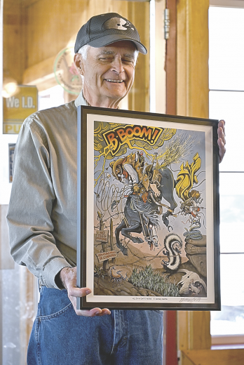 """David Peck photoByron native and artist Denney NeVille displays his large format cartoon work """"All in a Day's Work"""" that wowed art patrons attending the Buffalo Bill Annual Art Auction last September in Cody."""