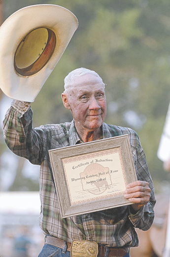 Nathan Oster photo  Dick Gifford of Lovell accepts the Wyoming Cowboy Hall of Fame certificate for his late father, Andy, during the Big Horn County Fair Rodeo Saturday evening.