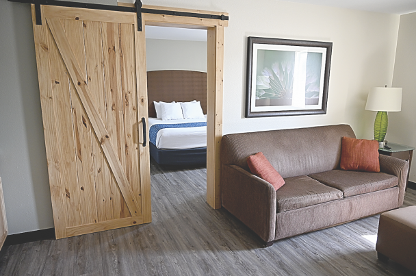 David Peck      The Lovell Travelodge now features newly furnished rooms such as this two-room suite that includes a pullout couch. The hotel re-opened in December following a year-long renovation.