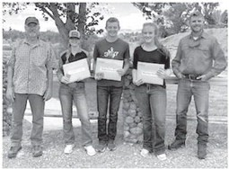 Courtesy Photo Left Bill Easterly, brother of Tom Easterly, and Sam Stephens (far right), local G& F biologist, pose for a photo with this year's recipients (l-r): Easterly, Avery Lewis, Kyler Winters and Hanna Haley and Stephens.